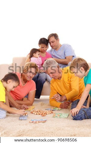 portrait of a big family playing on carpet