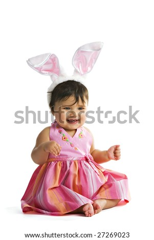 Portrait of a biracial baby dressed in pink and giant bunny ears. - stock photo