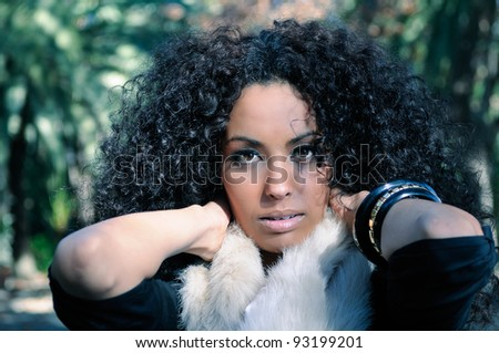 Portrait of a black beautiful woman in a park - stock photo