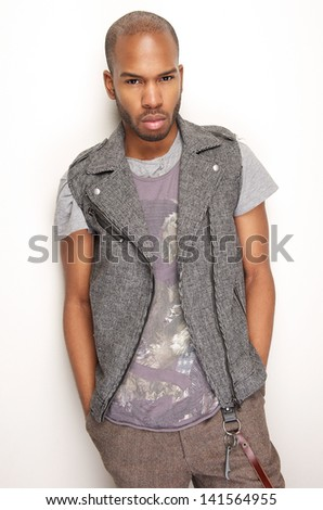 Portrait of a black fashion model posing against white wall - stock photo