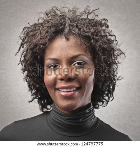 Portrait of a black girl with curly hair - stock photo