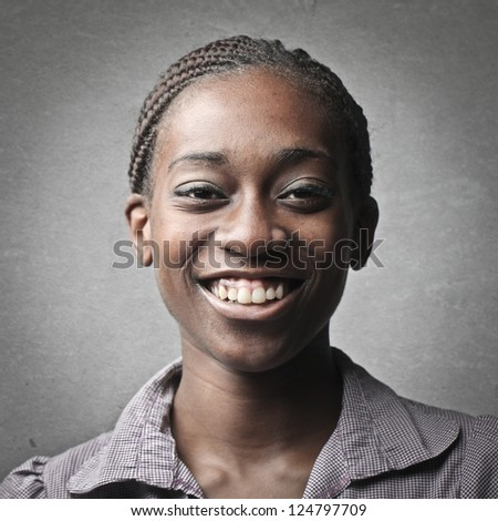 Portrait of a black girl with tied hair - stock photo