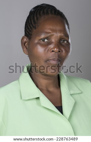 Portrait of a black middle aged woman making facial expressions and emotions - stock photo