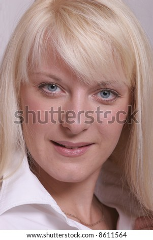 portrait of a blond girl smiling