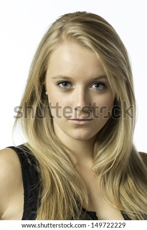 Portrait of a blond girl with blue eyes isolated on white background