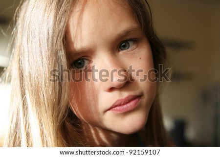 Portrait of a blond kid girl
