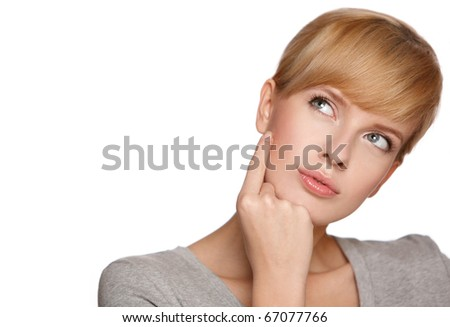 Portrait of a blond woman looking at copyspace, isolated on white background - stock photo