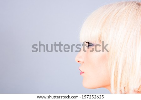 portrait of a blond woman. profile - stock photo