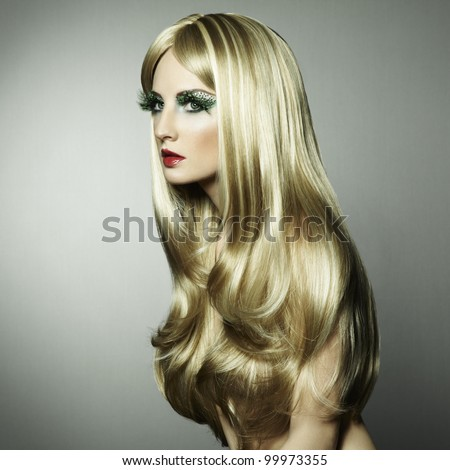 Portrait of a blond woman with long eyelashes. Fashion photo - stock photo