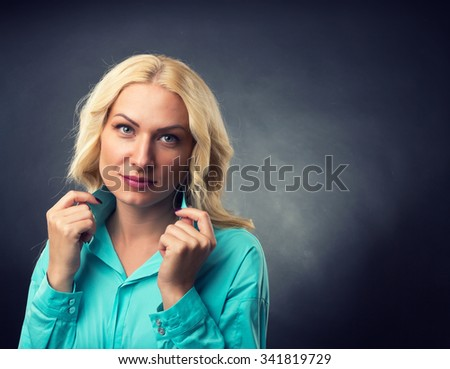 Portrait of a blonde beautiful woman - stock photo