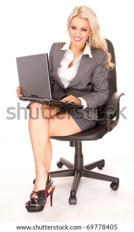 Portrait of a blonde businesswoman sitting in a chair, isolated on white background - stock photo