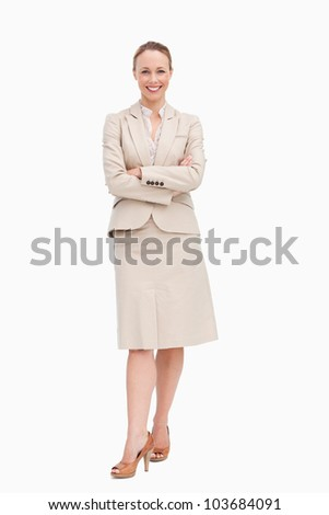 Portrait of a blonde businesswoman smiling against white background - stock photo