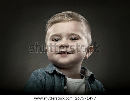 Portrait of a blonde child - stock photo