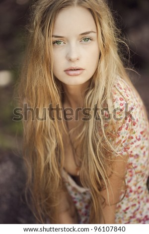 Portrait of a blonde girl with green eyes, a mermaid - stock photo