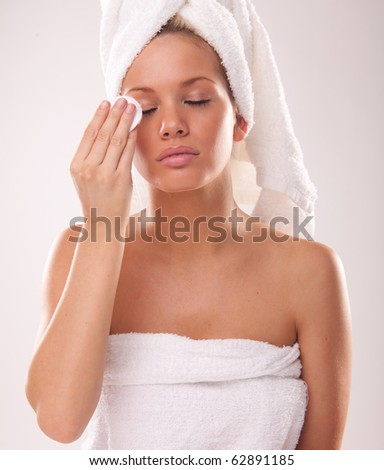 Portrait of a blonde  model. cleaning make-up - stock photo