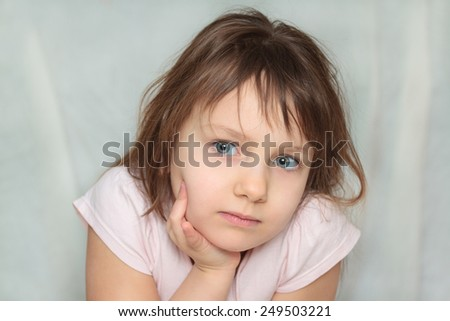 Portrait of a bored girl - stock photo