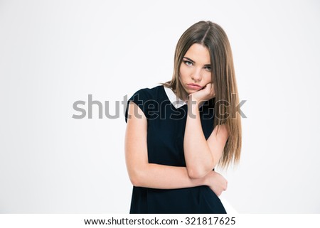 Portrait of a bored woman looking at camera isolated on a white background - stock photo
