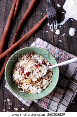 portrait of a bowl of muesli served with yogurt - stock photo