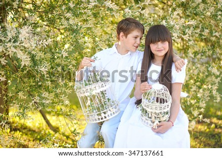 Portrait of a boy and girl  in summer - stock photo
