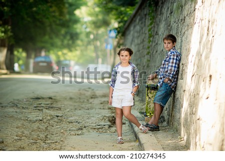 Portrait of a boy and girl outdoors
