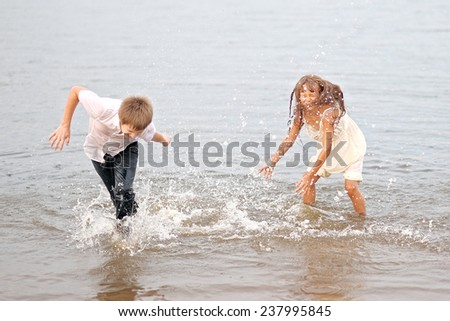 Portrait of a boy and girl playing on the beach