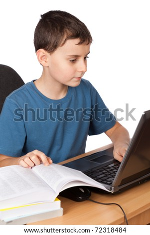 Portrait of a boy doing his homework at the laptop, isolated on white background