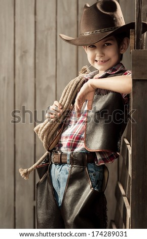 Portrait of a boy dressed as a cowboy - stock photo