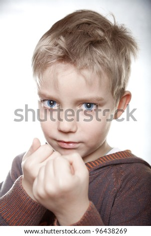 portrait of a boy going to fight with fists