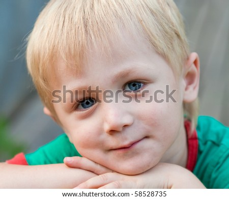 Portrait of a boy, his face close up - stock photo