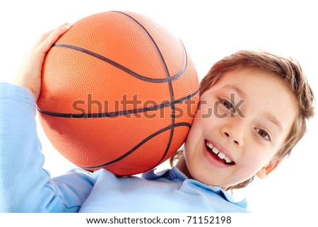 Portrait of a boy holding a basketball ball - stock photo
