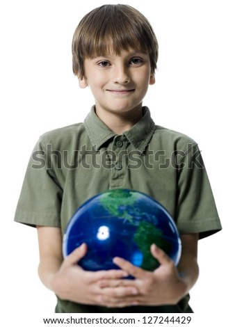 Portrait of a boy holding a globe