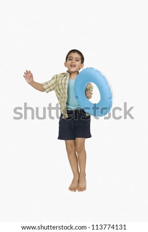 Portrait of a boy holding an inflatable ring