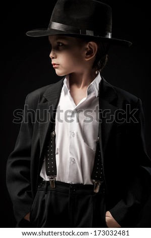 Portrait of a boy in an image of the gangster - stock photo