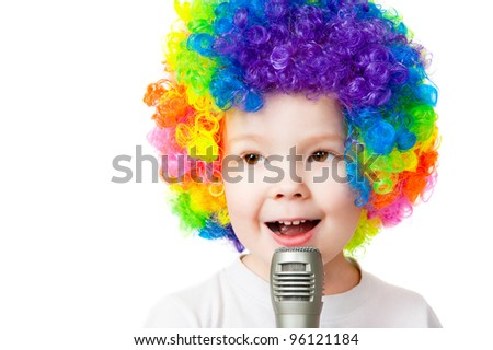 portrait of a boy in colored wig - stock photo
