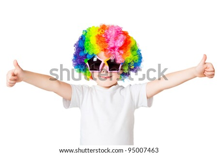 portrait of a boy in colored wig and glasses - stock photo