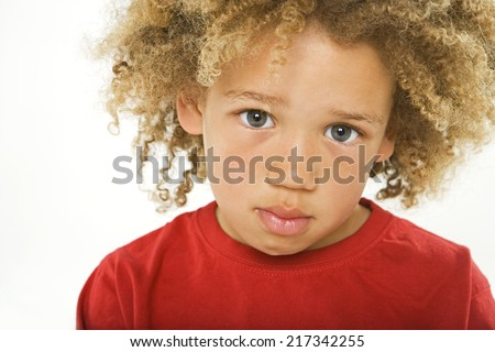 Portrait of a boy looking serious - stock photo