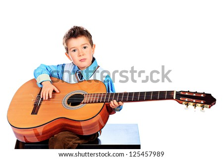 Portrait of a boy playing his guitar. Isolated over white background.