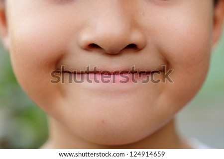 Portrait of a boy smiling - stock photo