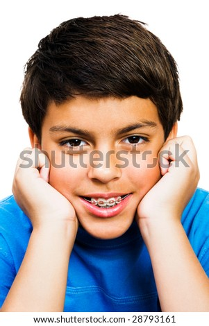 Portrait of a boy smiling isolated over white - stock photo