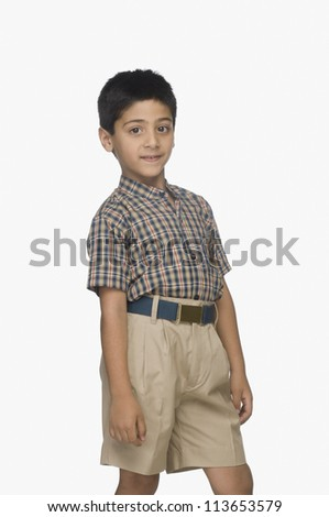 Portrait of a boy standing - stock photo