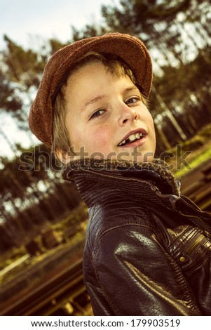 portrait of a boy wearing vintage clothes and beret, with instagram style effect - stock photo