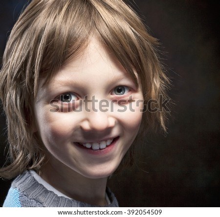 Portrait of a Boy with Blond Hair Smiling  - stock photo