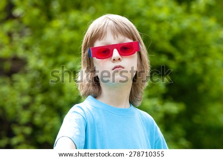 Portrait of a Boy with Funny Red Glasses Looking  - stock photo