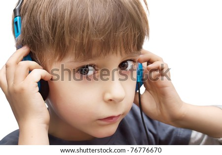 portrait of a boy with headphones isolated on white background - stock photo