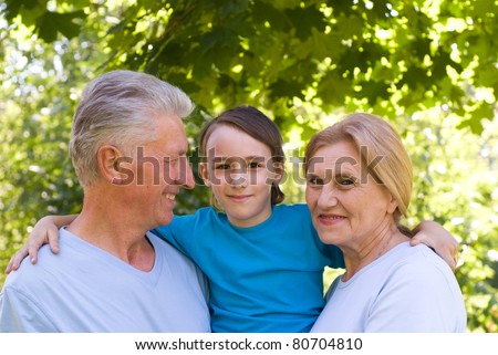 portrait of a boy with his grandparents