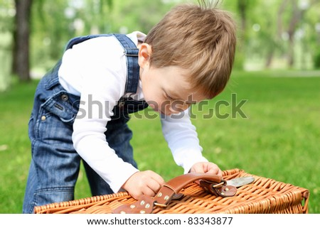 Portrait of a boy working with a busket in the park - stock photo