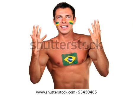 Portrait of a brazilian football fan with flag on his body and face, isolated on white - stock photo