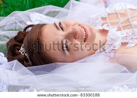 Portrait of a bride on the grass