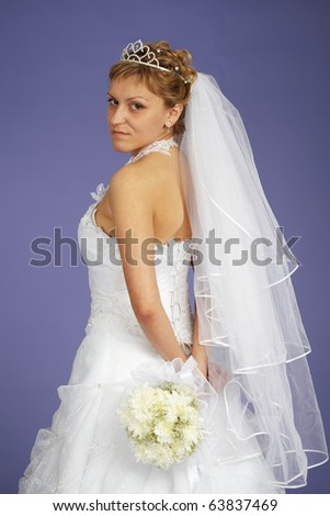 Portrait of a bride with a bouquet of flowers - stock photo
