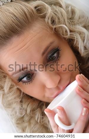 portrait of a bride with a cup of Black Coffee - stock photo